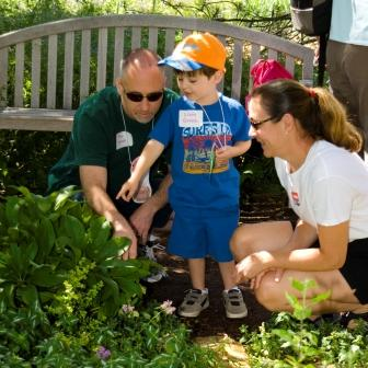 Family exploring edible gifts from the garden