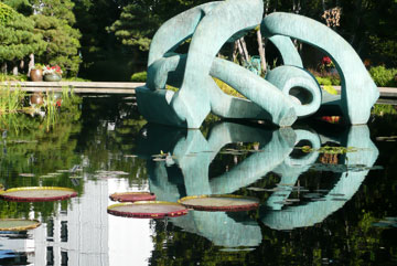 Hill Arches 1973 (LH636), image reproduced by permission of The Henry Moore Foundation. Victoria waterlilies in he Monet Pool.