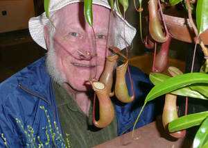 Eighty-years young Denver Botanic Gardens' super volunteer Larry Knowles and Nepenthes alata at our Information Desk.